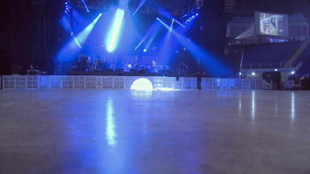 ws o2 arena with stage lights and empty floor in foreground / london, london, uk - コンサート点の映像素材/bロール
