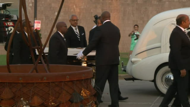 Aretha Franklin's gold casket being carried into the Charles H Wright Museum of African American History in Detroit