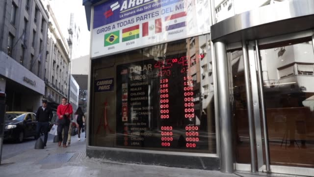 vídeos y material grabado en eventos de stock de argentina faces a new devaluation record of its currency as inflation remains high and it will take some time to bring it down but the international... - devaluation