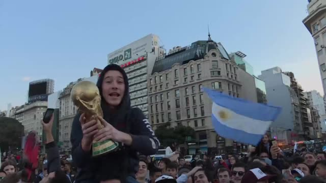Argentina fans cheer their national team after they survived and won a crucial World Cup against Nigeria 21 to advance to the round of 16 saying they...