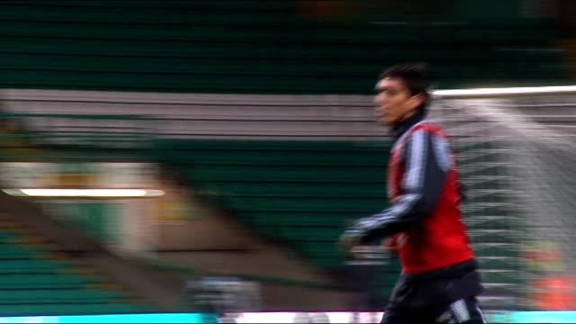 Argentina team training at Celtic Park Fabricio Coloccini running around pitch / Luis Gonzalez jogging around pitch / Martin Demichelis / Maxi...