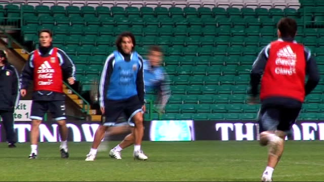 Argentina team training at Celtic Park Tevez during practice match / More of Maradona watching team / General view empty Celtic Park stadium interior...