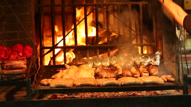 argentine barbecue - uruguay stock-videos und b-roll-filmmaterial