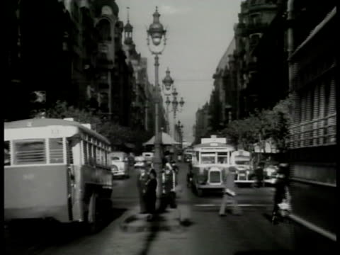 vidéos et rushes de argentine building street ws argentineans crossing wide street traffic trolleys vs elegant buildings houses elaborate grand house ws building w/... - argentine
