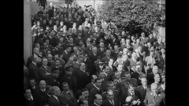 Argentine crowds amp officials standing on street INT MS New President General Julian Farrell giving speech at podium crowds around WWII
