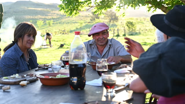 argentine gaucho family sitting outdoors for midday meal - argentinian culture stock videos & royalty-free footage