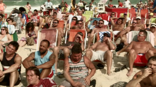 argentine soccer team fans watch their team plays against the iran team on the screen setup at the word cup fifa fan fest during on copacabana beach... - large scale screen stock videos & royalty-free footage