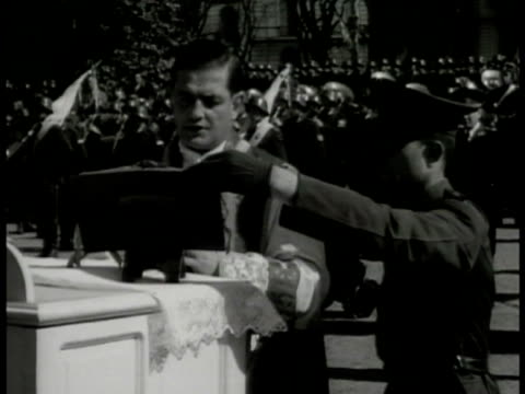argentine soldiers at outdoor mass priest cross. msgr. julian martinez reading bible at altar soldiers bg. children in white dresses flowers.... - priest stock videos & royalty-free footage