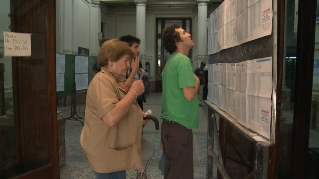 argentine voters express mixed feelings over presidential candidates and agree today's election is really important for the country after a campaign... - mauricio macri stock videos and b-roll footage