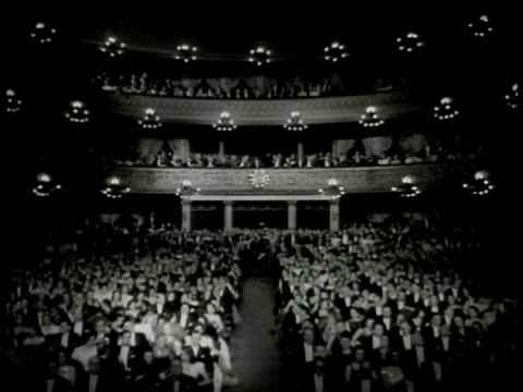 argentinean putting up 'carmen' opera poster int ws filled opera house balconies ws curtains opening on stage dancers ha ws orchestra conductor music... - opera stock videos & royalty-free footage