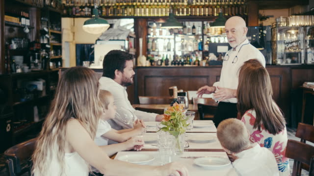 argentinian chef is introducing todays menu to restaurant guests - listening stock videos & royalty-free footage