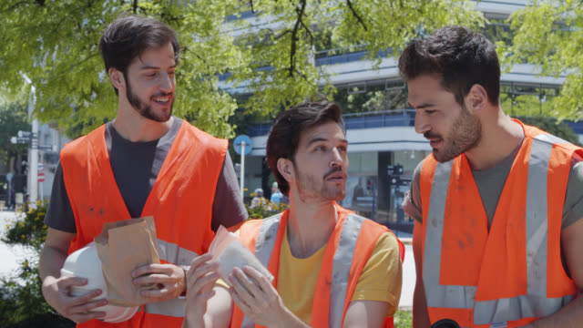 argentinian construction workers on lunch break - lunch break stock videos & royalty-free footage