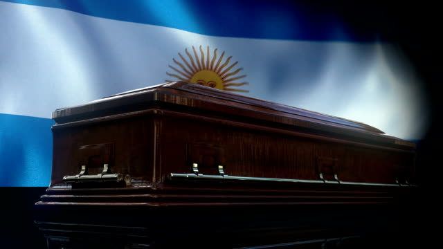 argentinian flag behind coffin - argentinian culture stock videos & royalty-free footage