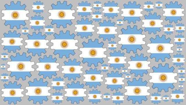 argentinische flagge zahnräder drehen hintergrund - argentinische flagge stock-videos und b-roll-filmmaterial