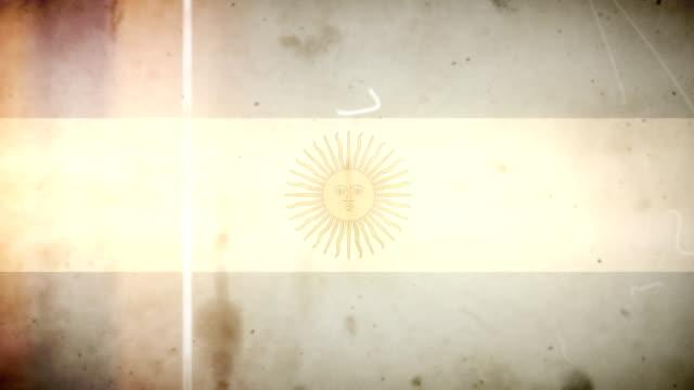 vídeos de stock e filmes b-roll de bandeira argentina-grunge retro velho filme loop com áudio - fuga de luz