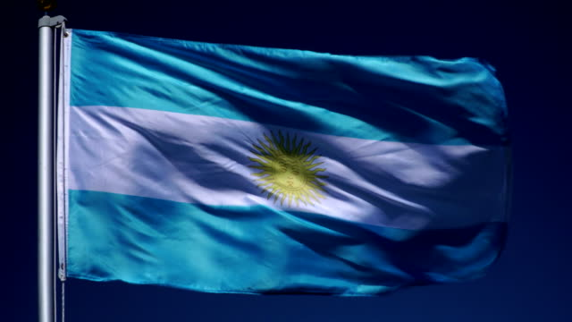 4K: Argentinian Flag on Flagpole in front of Blue Sky outdoors (Argentina)
