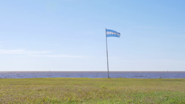 argentinian flag waving in the coast - buenos aires province stock videos & royalty-free footage