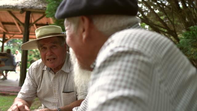 argentinian gauchos talking at the farmerhouse - basco video stock e b–roll