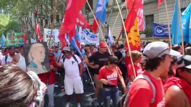 argentinian protesters march to the plaza de mayo square as part of a national strike to protest the massive layoffs of state workers during the... - mauricio macri stock videos and b-roll footage