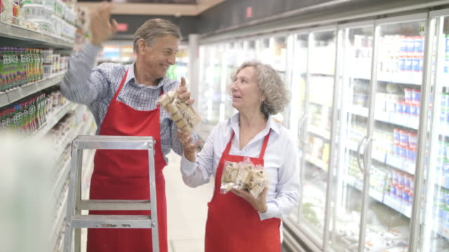 argentinian seniors working at supermarket - ladder stock videos & royalty-free footage