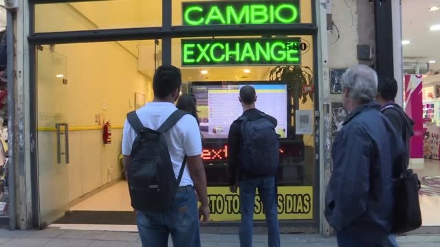 argentinians react to a day of inflation and devaluation as the peso plummets 764% against the us dollar an unwelcome reminder of the 1980s... - devaluation stock videos and b-roll footage