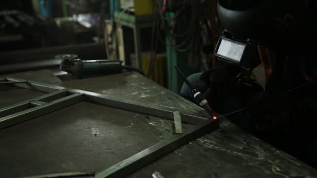 argon welding, masked workers and leather gloves for safety, argon welding in industrial plants. - mitten stock videos and b-roll footage