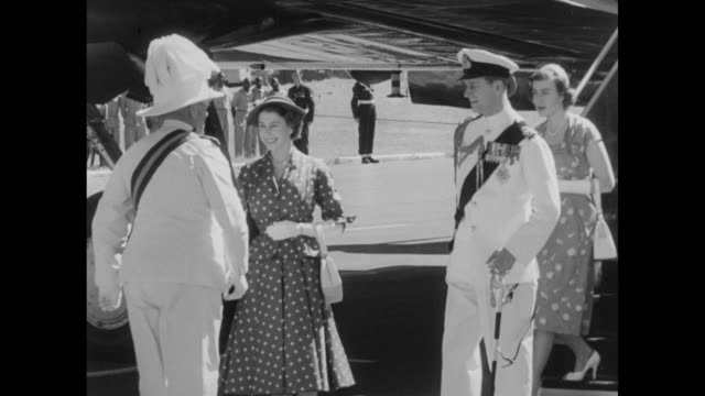 "Argonaut plane ""Atalanta"" plane taxis on runway / Princess Elizabeth and Prince Philip Duke of Edinburgh deplane greet Kenya's Governor Sir Philip..."