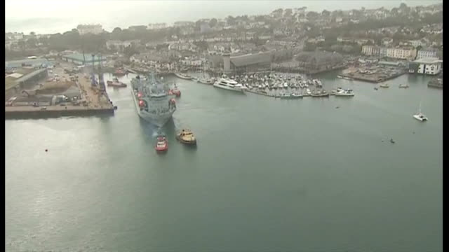 argus departs falmouth for sierra leone. exterior shots aerials rfa argus docked in falmouth port ready to follow tug boats. on october 17, 2014 in... - 英国海兵隊点の映像素材/bロール