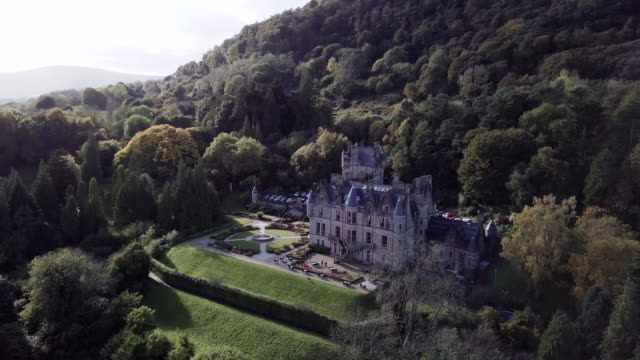 arial shot of belfast castle on an autumn afternoon in 4k. - ireland stock videos & royalty-free footage