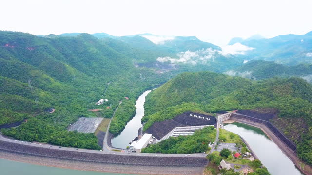 arial view of big dam with misty after rain, thailand - tropical climate stock videos & royalty-free footage