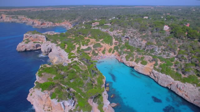 Arial View of Caló des Moro (Cala de Sa Comuna) , Cala s'Almunia and Peninsula of Castellet de Llevant on east coast near by Cala Llombards and Santanyí on Spanish Balearic island of Majorca / Spain