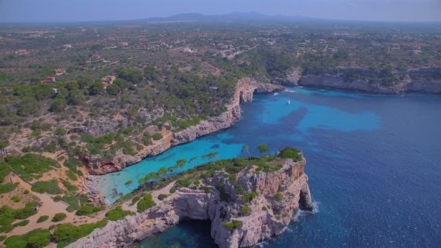 arial view of caló des moro (cala de sa comuna) , cala s'almunia and peninsula of castellet de llevant on east coast near by cala llombards and santanyí on spanish balearic island of majorca / spain - balearic islands stock videos and b-roll footage