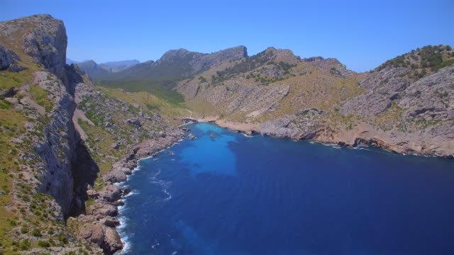 arial view of cala figuera and mountain range serra de tramuntana near the cap formentor on spanish balearic island of majorca / spain - peninsula stock videos and b-roll footage