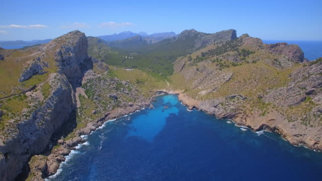 arial view of cala figuera and mountain range serra de tramuntana near the cap formentor on spanish balearic island of majorca / spain - cliff stock videos & royalty-free footage