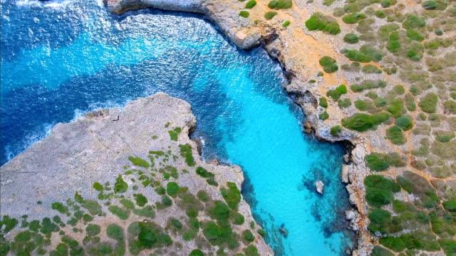 Arial vista de Cala Petita una bahía en la costa este en Español Baleares isla de Mallorca