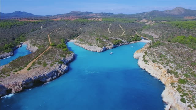 arial view of calas (cala virgili , cala pilota , cala magrana) on east coast on spanish balearic island of majorca / spain - majorca stock videos & royalty-free footage