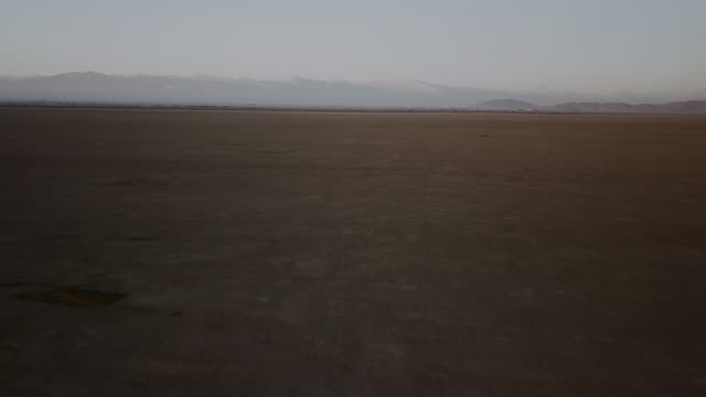 arial view of dry lake bed and desert - lake bed stock videos & royalty-free footage