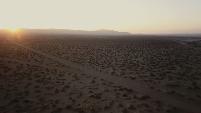 arial view of dry lake bed and desert - terra brulla video stock e b–roll