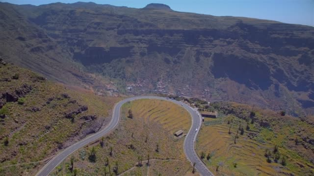 Arial View of Hairpin turns and Observation Point ' Mirador del Palmarejo ' near by Valle Gran Rey on Canary Islands La Gomera in the province of Santa Cruz de Tenerife - Spain