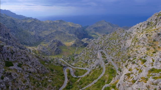 arial view of mountain range with hairpin turn nearby sa calobra - sierra de tramuntana / majorca - spain - balearics stock videos & royalty-free footage