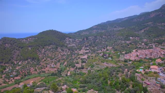 arial view of mountain village banyalbufar by sierra de tramuntana on balearic island of majorca - land feature stock videos & royalty-free footage