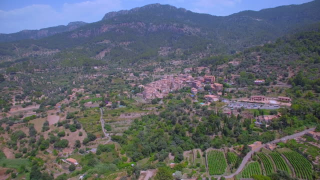 arial view of mountain village banyalbufar on balearic island of majorca by sierra de tramuntana - land feature stock videos & royalty-free footage