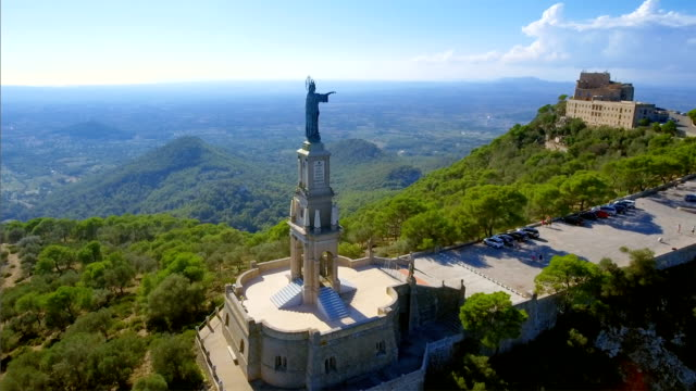arial view of santuari de sant salvador monastery and christ the king monument - majorca / spain - spain stock videos & royalty-free footage