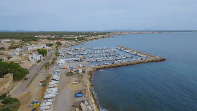 Arial View of S'Estanyol de Migjorn beach and harbor near by Sa Rapita on southern coast on Spanish Balearic island of Majorca / Spain