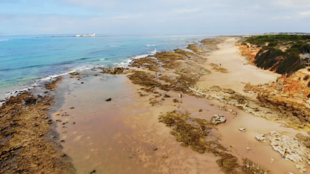 arial view of the spanish coast with low tide - cádiz stock videos and b-roll footage