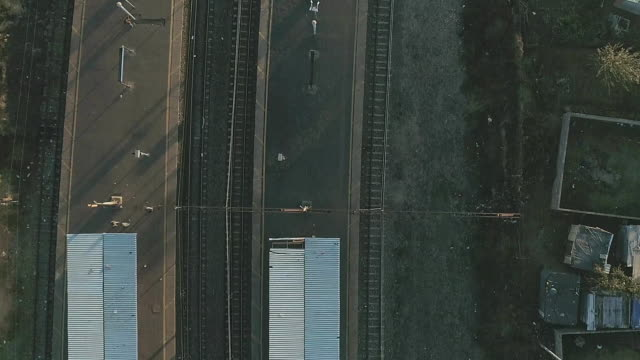 arial view of train tracks in dobsonville/ soweto/ south africa - railway track stock videos & royalty-free footage