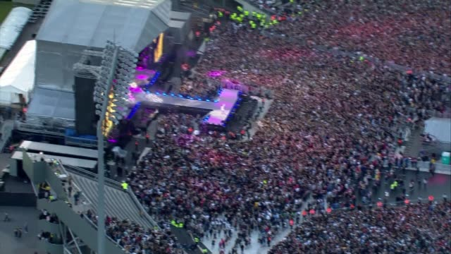 ariana grande one love manchester concert aerials england manchester aerial shots arianna grande performing on stage / liam gallagher on stage - manchester england stock videos & royalty-free footage
