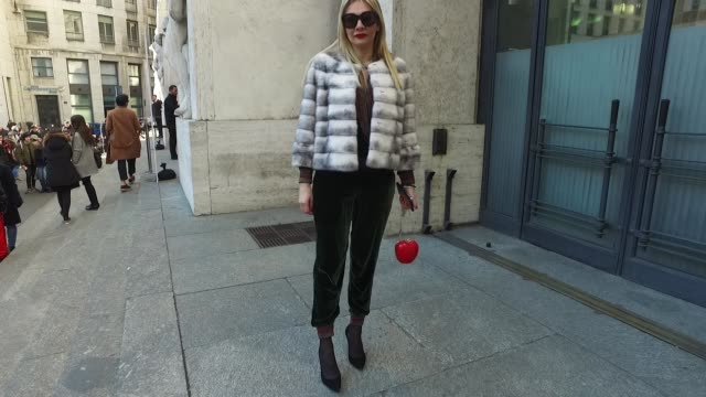 arianna eleonora fiorini is wearing stuart weitzman shoes wolford tights intermix jumpsuit annabella fur valentino purse and emanuelle khann... - jumpsuit stock videos and b-roll footage