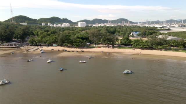 ariel view of  fisherman village near laem chabung port in chonburi province, thailand. - chonburi province stock videos & royalty-free footage