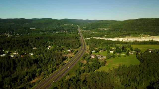 ariel view of highway cutting through forest o - massachusetts stock videos & royalty-free footage